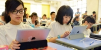 Students of United Christian College (Kowloon East) use iPads during lessons